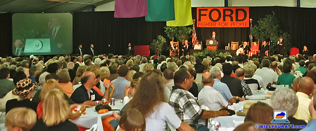 "Vice President Al Gore addresses a crowd of more than 2,000 people crowded into a tent at the Kentucky Horse Park for a tribute honoring retiring Sen. Wendell H. Ford on Saturday, July 18, 1998 in Lexington, Ky. ""Wendell Ford has done more good things for more people than probably any other Kentuckian in the 20th century,"" Gore said. (Photo © 1998 Billy Suratt/Apex MediaWire)"