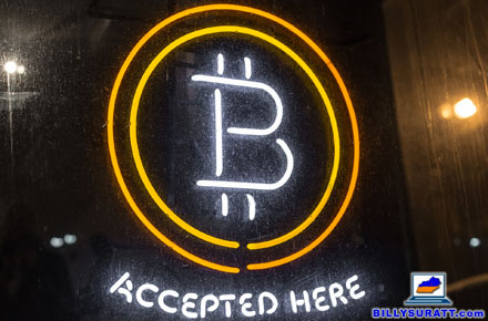 """A neon sign outside an establishment proclaims """"Bitcoin accepted here."""" Bitcoin introduced the """"cryptocurrency"""" concept to the world in 2009. (Photo © 2014 Duncan Rawlinson/Flickr) (CC BY-NC 2.0)"""