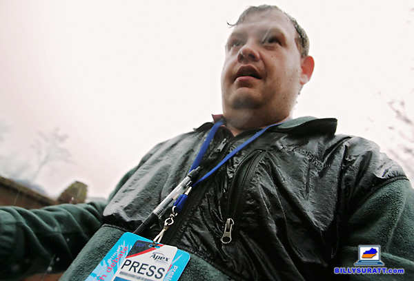 Mid-South photojournalist and Kentucky photographer Billy Suratt getting soaked by rain while on the campaign trail covering former House Speaker New Gingrich's 2012 presidential campaign in South Carolina.