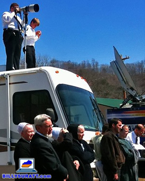 Photographing a Mennonite funeral while standing on top of an RV. (© 2010 Carmen K. Sisson/Apex MediaWire)
