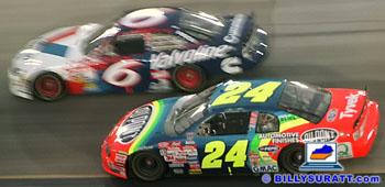 Mark Martin passing Jeff Gordon at a NASCAR race.