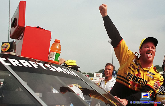 No. 19 Pennzoil Ford driver Tony Raines celebrates a Kroger 225 NASCAR Craftsman Truck Series win on Saturday, Aug. 29, 1998 at Louisville Speedway in Louisville, Ky. Capturing post-race celebrations in the winner's circle is an important part of race photography. (Photo by Billy Suratt)